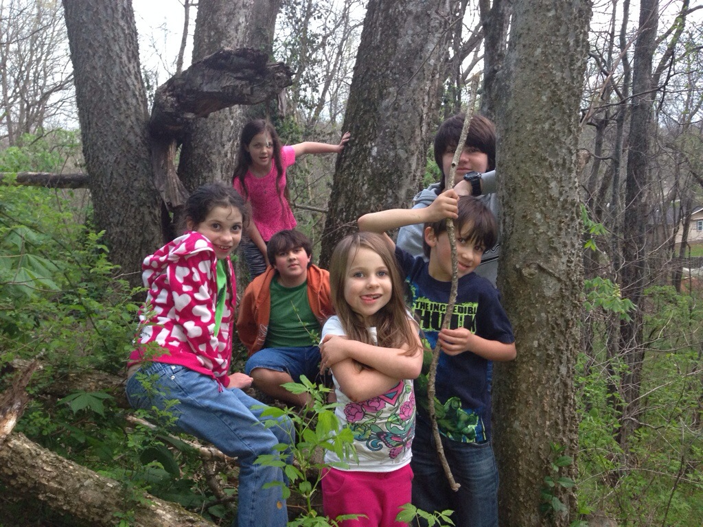 Spring 2014. All 6 kids gathered around their favorite tree in the woods behind the house.