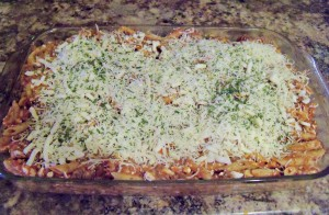 Unbaked casserole with cheese and parsely